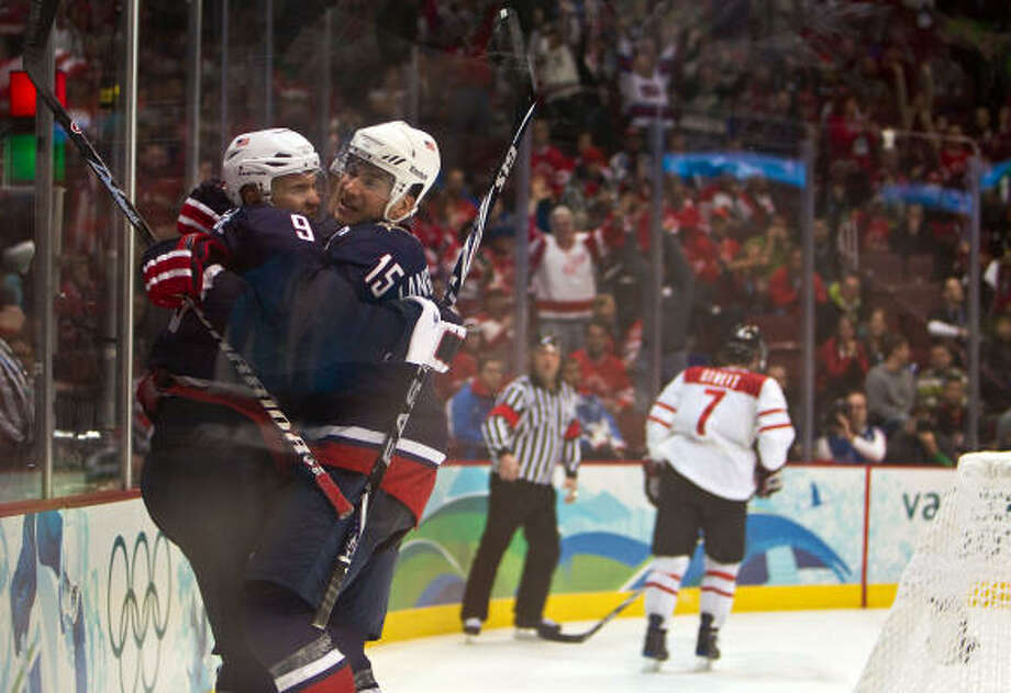 Team USA's Jamie Langenbrunner (15) celebrates with Zach Parise after Parise scored an empty-net goal in the closing moments of the United States' 2-0 victory in a quarterfinal Feb. 24. Photo: Smiley N. Pool, Chronicle Olympic Bureau