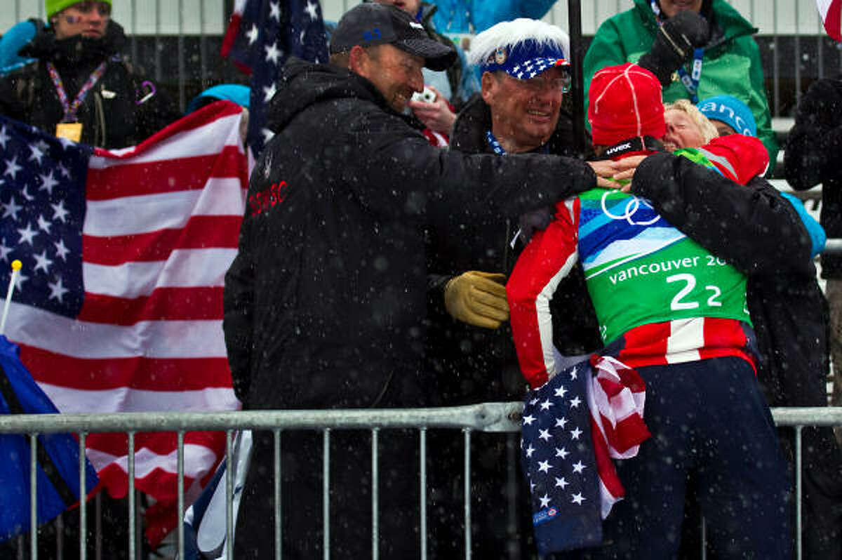 Todd Lodwick jumps up into the stands to celebrate with his parent.