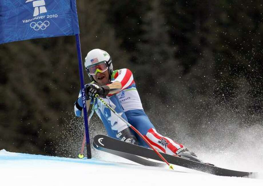 Bode Miller of the United States powers past a gate moments before skiing out during the first run of the men's giant slalom Feb. 23. Photo: Luca Bruno, AP
