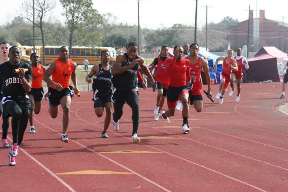 It's the second leg of the boys 400-meter relay. Photo: Gerald James, Chronicle