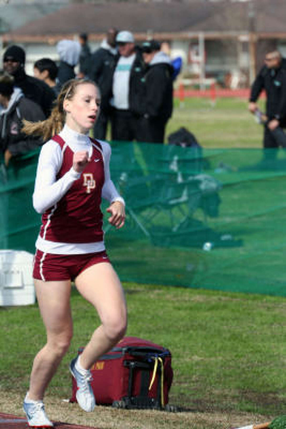 Jessica Whitt of Deer Park taking the 800-meter run in 2:20.57 seconds.