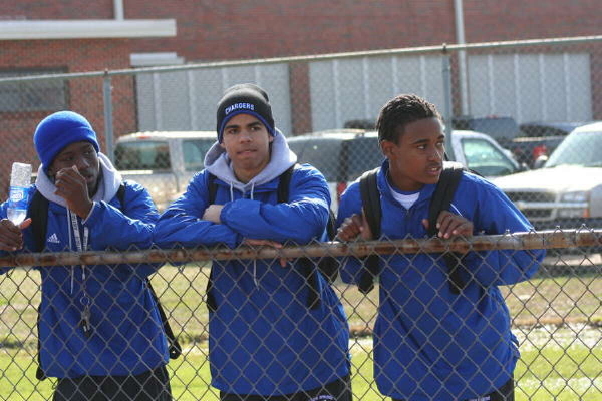 Clear Springs's Trey Terry, left, Jessie Washington, center, and Marcus Johnson found a good spot to just watch the action.