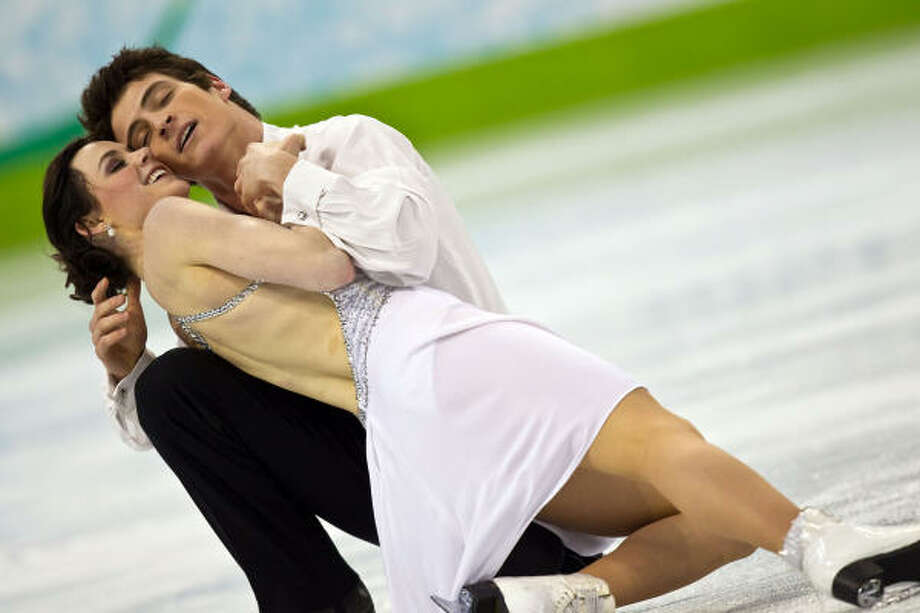 Tessa Virtue and Scott Moir of Canada won by a comfortable margin for the nation's first ice dancing gold medal. Photo: Smiley N. Pool, Chronicle Olympic Bureau