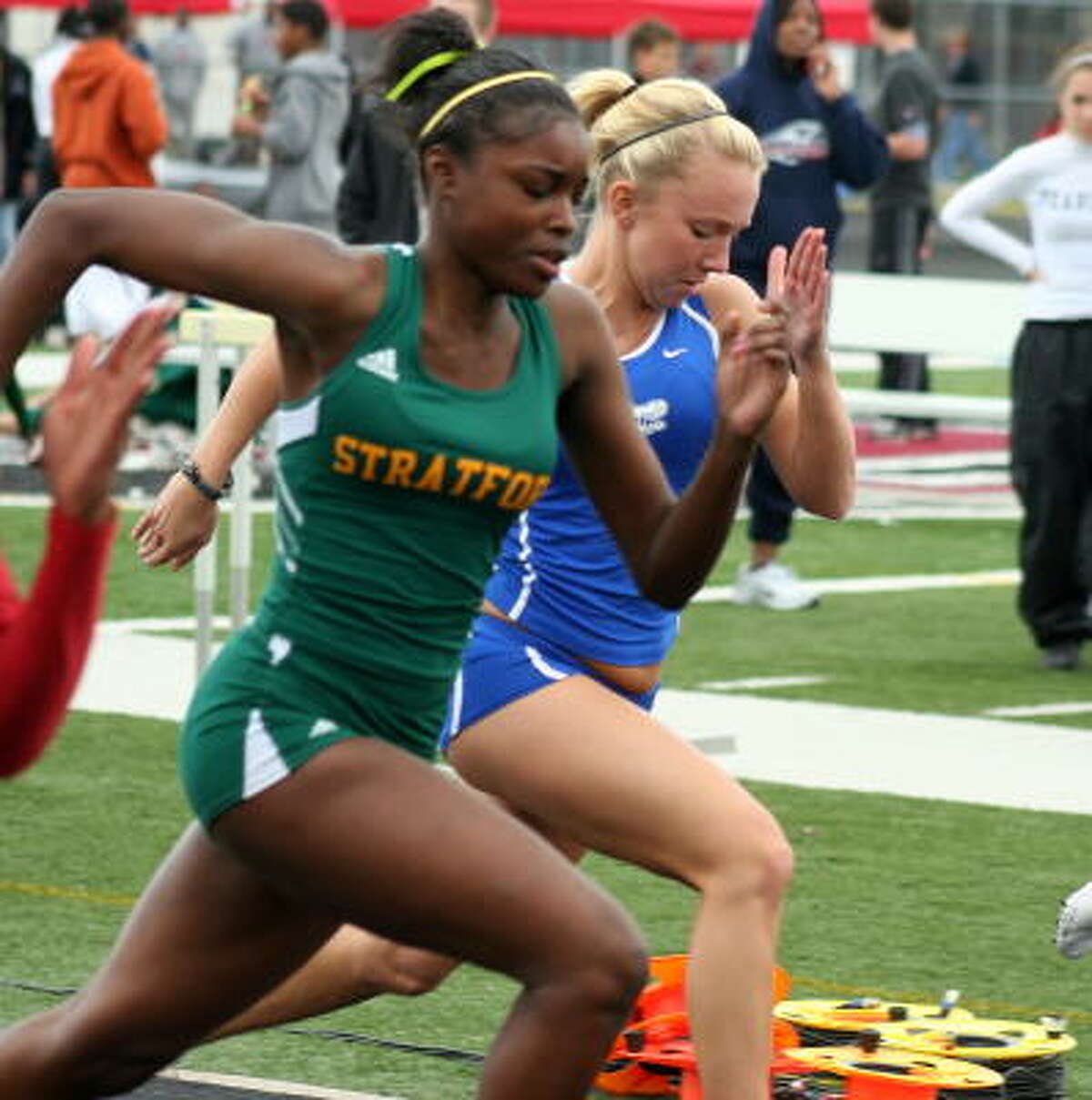 Stratford's Shamaujae Crokett, left, competes in a track event.