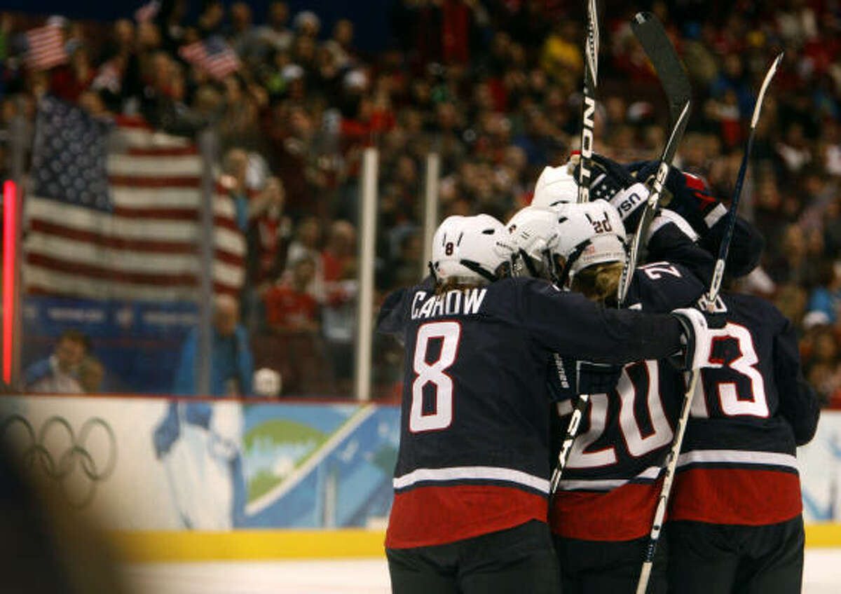 United States players celebrate Meghan Duggan's goal against Sweden in a 9-1 semifinal victory Feb. 22.