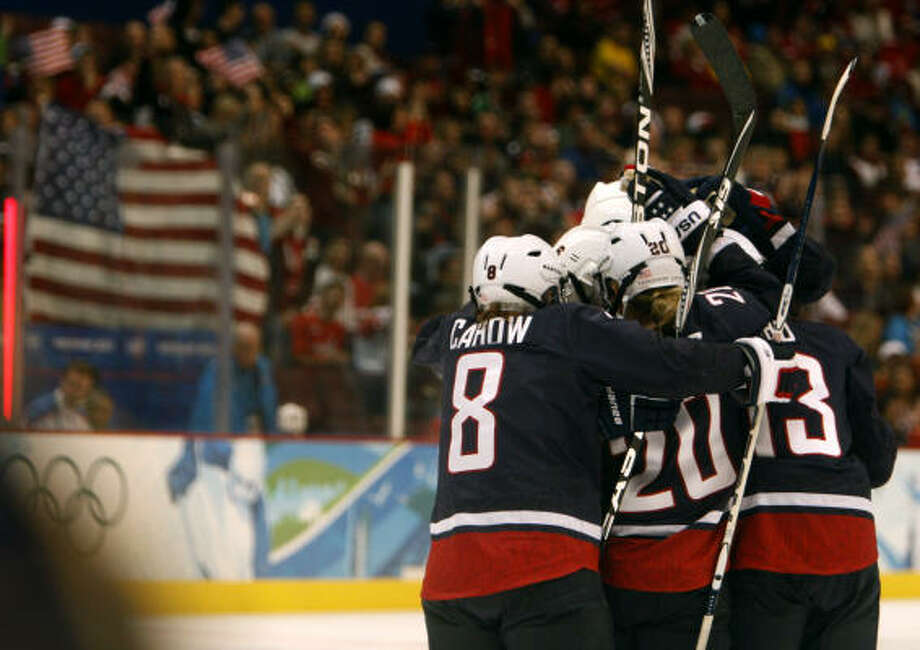 United States players celebrate Meghan Duggan's goal against Sweden in a 9-1 semifinal victory Feb. 22. Photo: Paul Chinn, Chronicle Olympic Bureau