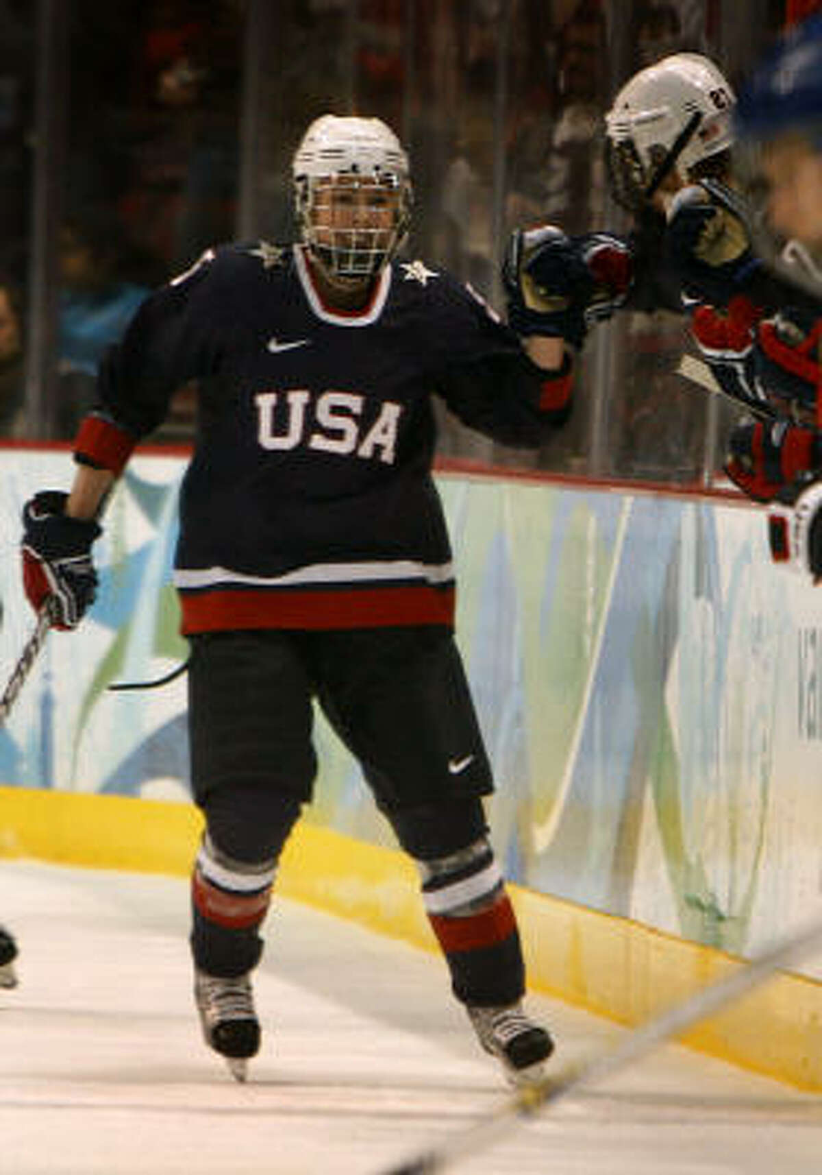 Karen Thatcher of the United States skates back to the bench after scoring a goal.