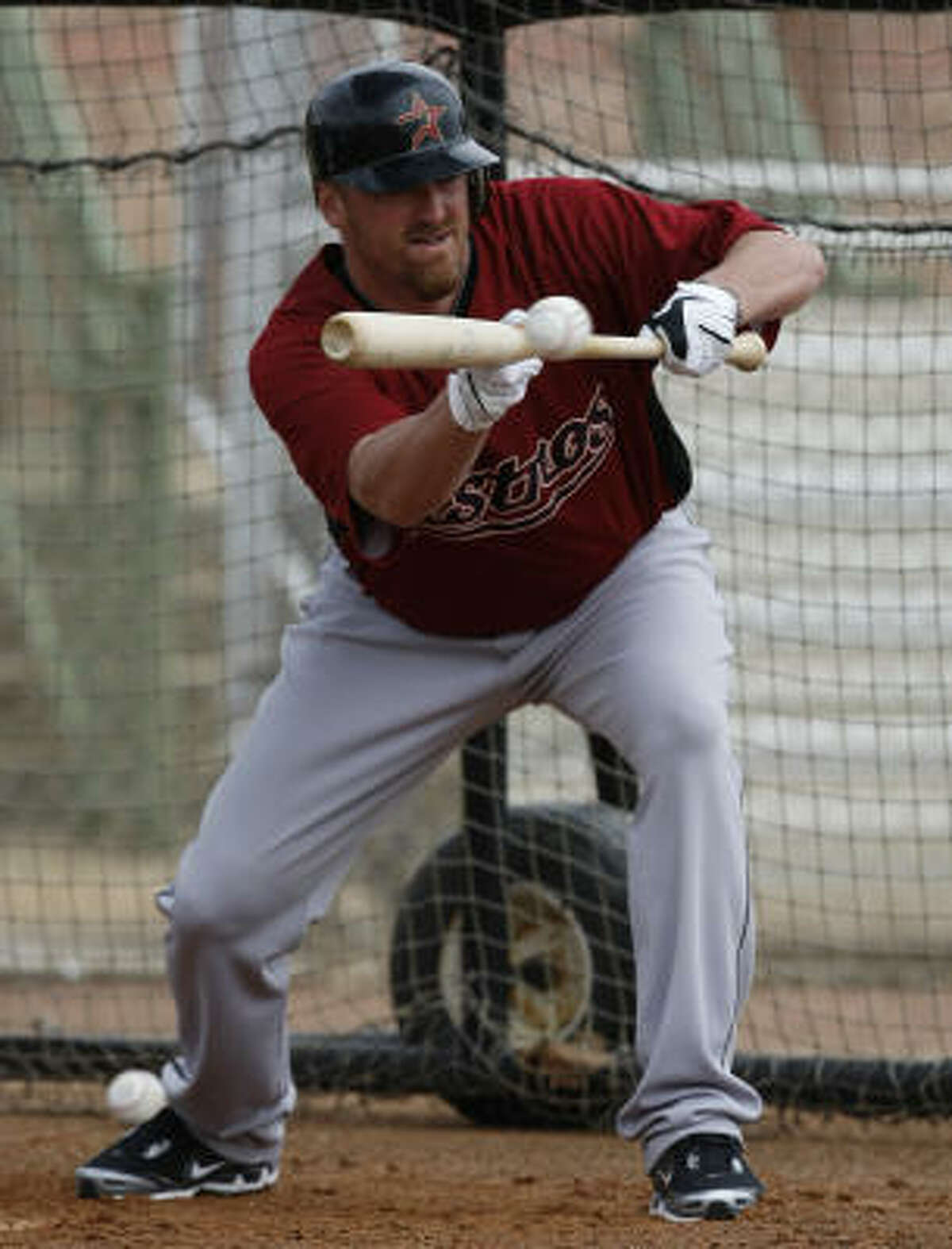 Pitcher Brett Myers works on his bunting form during Day 3 of spring training.