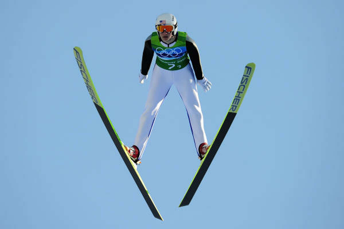 Peter Frenette of the United States soars through the sky during team competion.