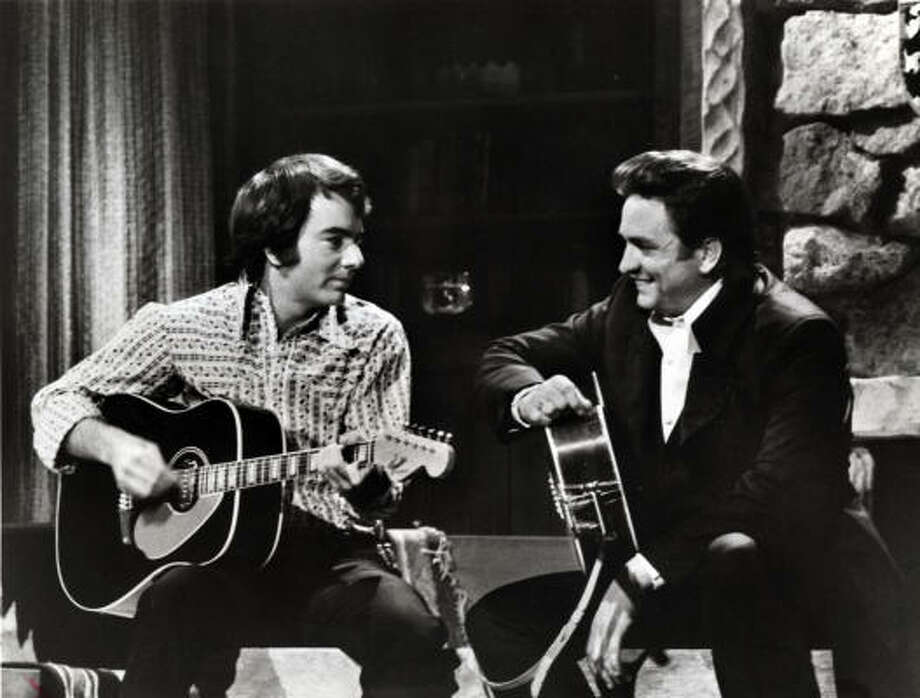 From 1969-1971 Cash starred in his own television show, The Johnny Cash Show. Such notable performers included Neil Young, Louis Armstrong, Kenny Rogers, James Taylor, Ray Charles, Eric Clapton, Bob Dylan and Neil Diamond (pictured). Photo: ABC