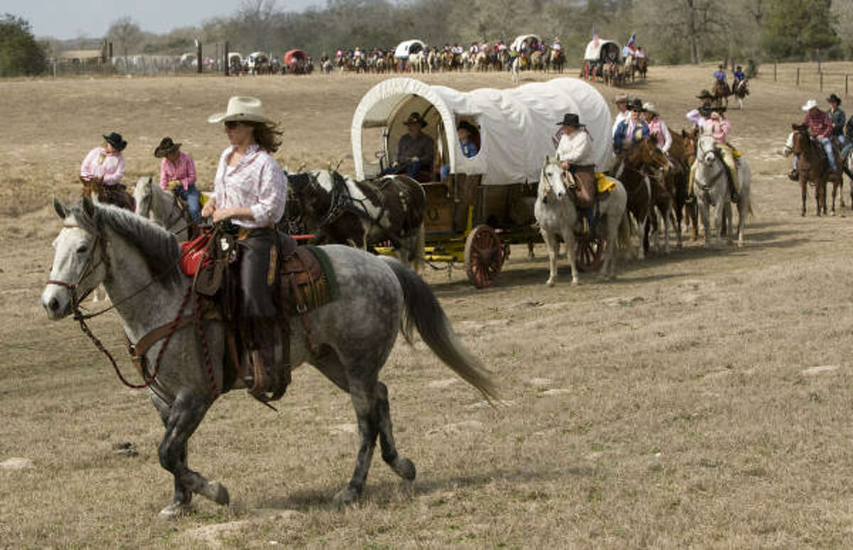 The Salt Grass Trail Riders take off from the 7IL Ranch during their ride in Cat Spring.