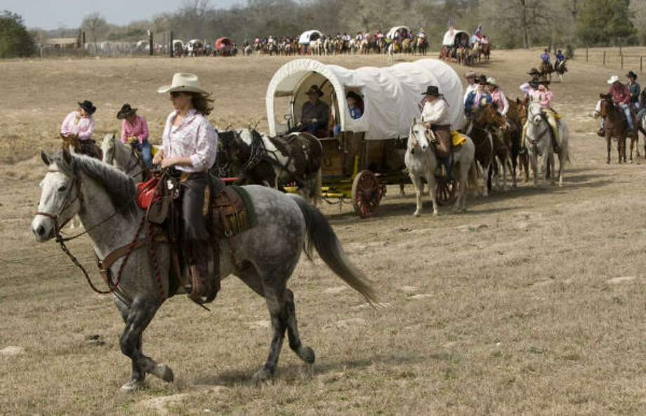 The Salt Grass Trail Riders take off from the 7IL Ranch during their ride in Cat Spring. Photo: Brett Coomer, Chronicle