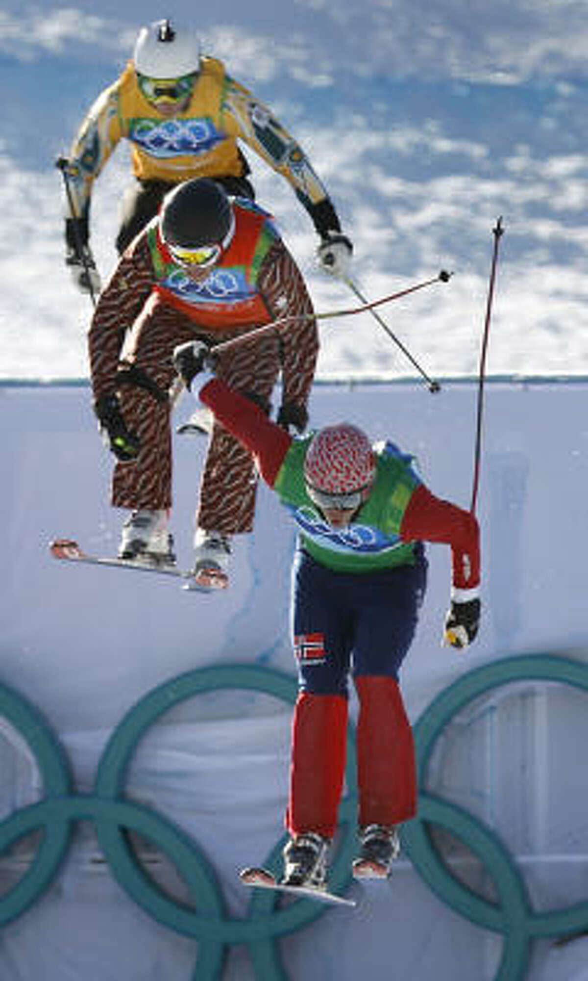 Norway's Audun Groenvold leads Canada's Chris Del Bosco and Scott Kneller of Australia to the finish line in a semifinal race of the men's ski cross competition.
