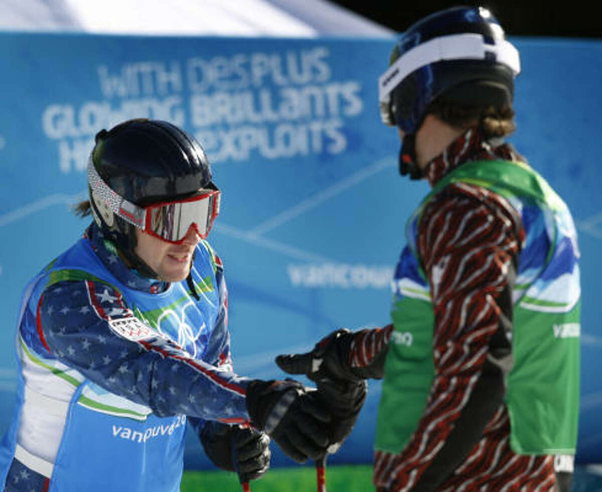 Casey Puckett, left, of the United States congratulates Canada's Stanley Hayer for advancing to the quarterfinals of the men's ski cross competition. Puckett was eliminated after finishing fourth in the heat.