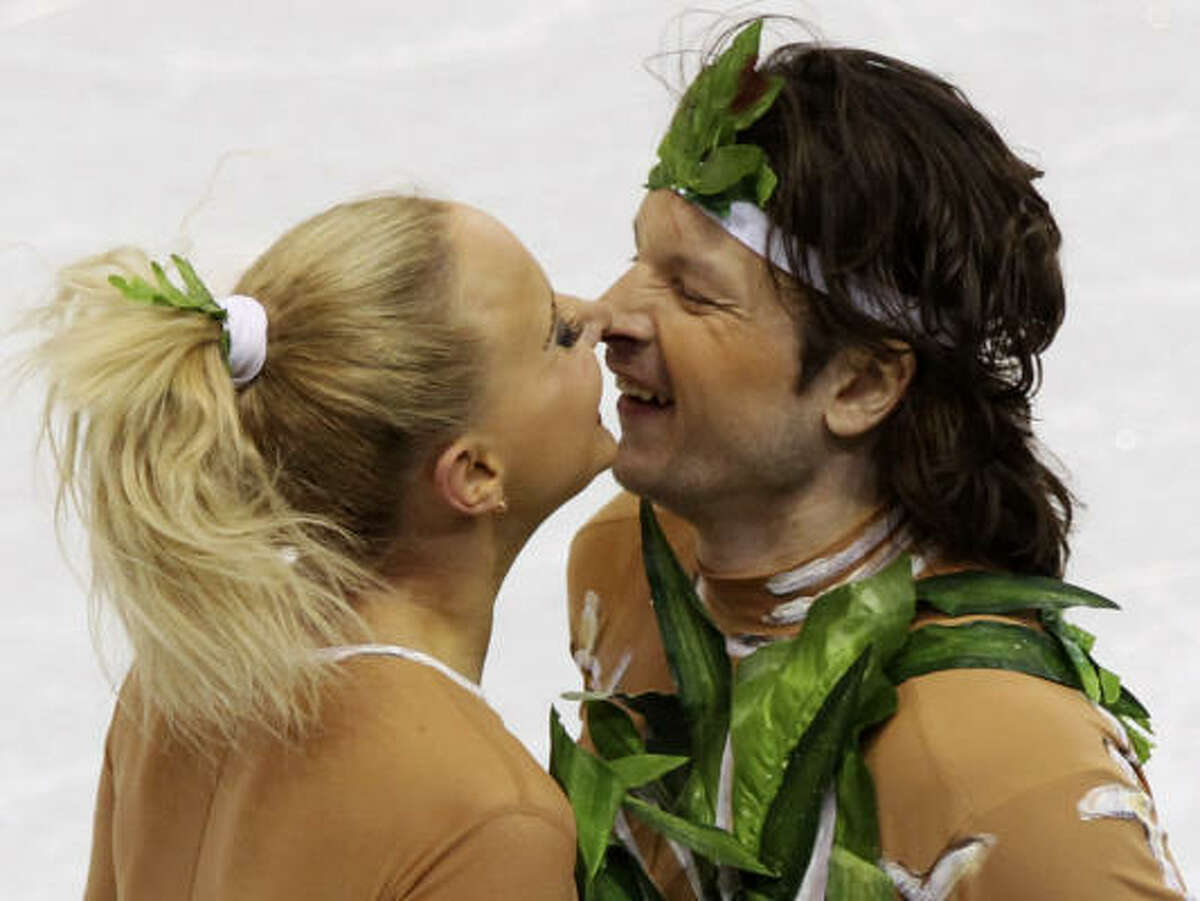 Russia's Oksana Domnina and Maxim Shabalin rub their noses together after performing their original dance.