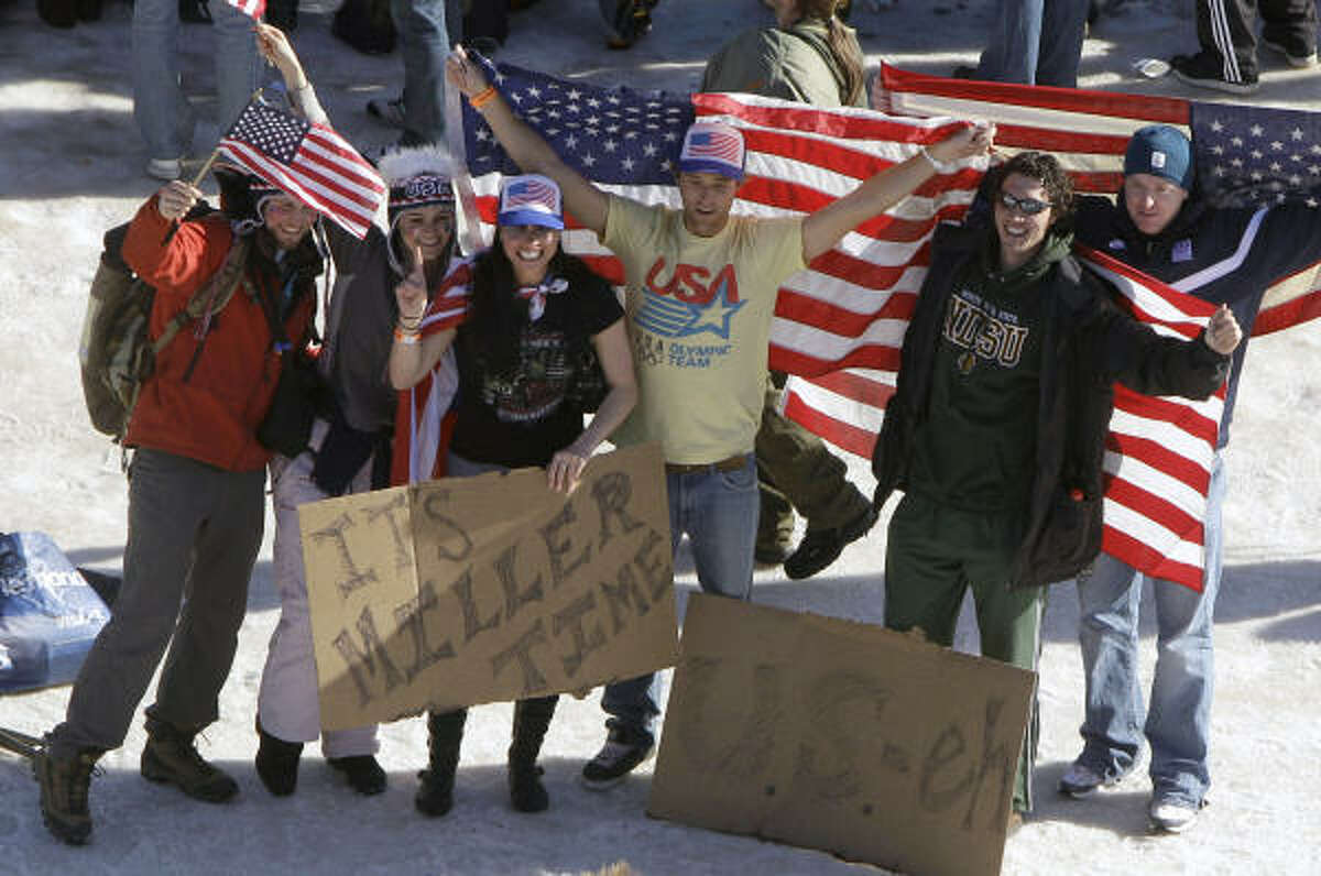 Fans celebrate after Bode Miller brought another gold to America in what has been a very successful winter for the Stars and Stripes on the slopes.