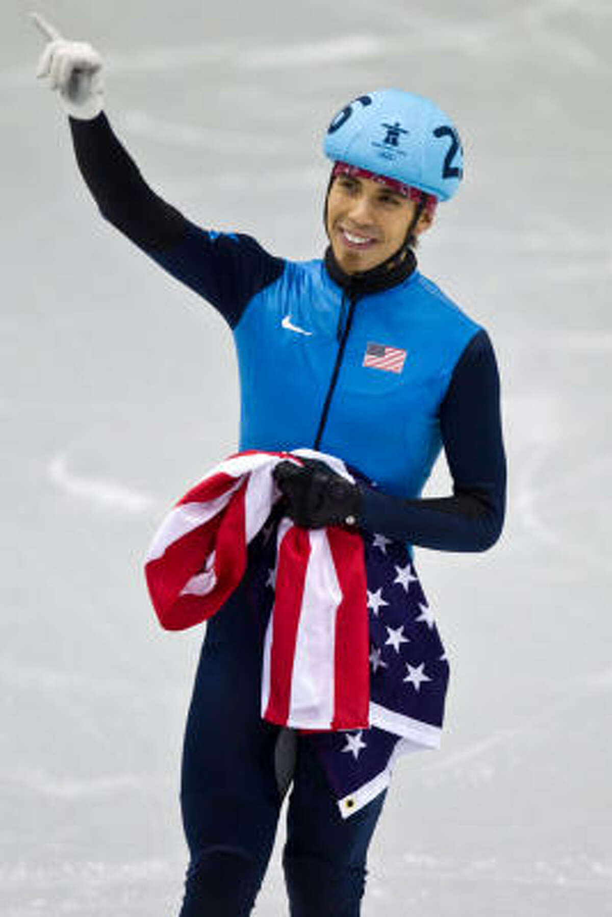 Team USA's Apolo Anton Ohno waves to the crowd after the men's 1,000-meter short track speedskating final on Feb. 20. Ohno won the bronze for his seventh all-time medal, breaking the record for most medals by a U.S. athlete in the Winter Games.