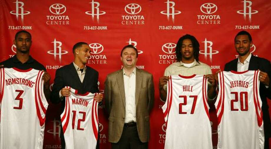 Rockets general manager Daryl Morey, center, introduced the team's four new players from Thursday's trade with Sacramento and New York at a press conference Friday. The players are center Hilton Armstrong (3), guard Kevin Martin (12), forward Jordan Hill (27) and forward Jared Jeffries (20). Armstrong and Martin were acquired from Sacramento, and Hill and Jeffries were obtained from New York. Photo: Michael Paulsen, Chronicle