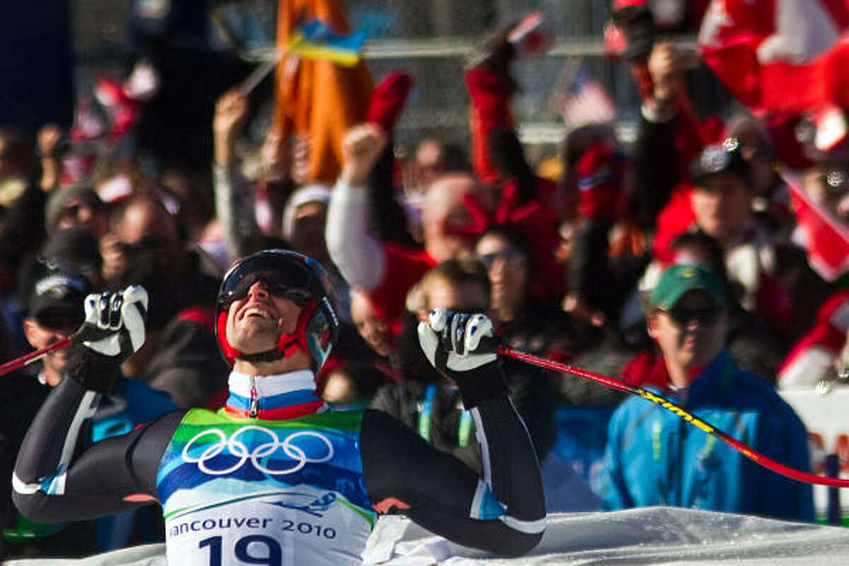 Norway's Aksel Lund Svindal celebrates at the finish line. Svindal won the gold medal.