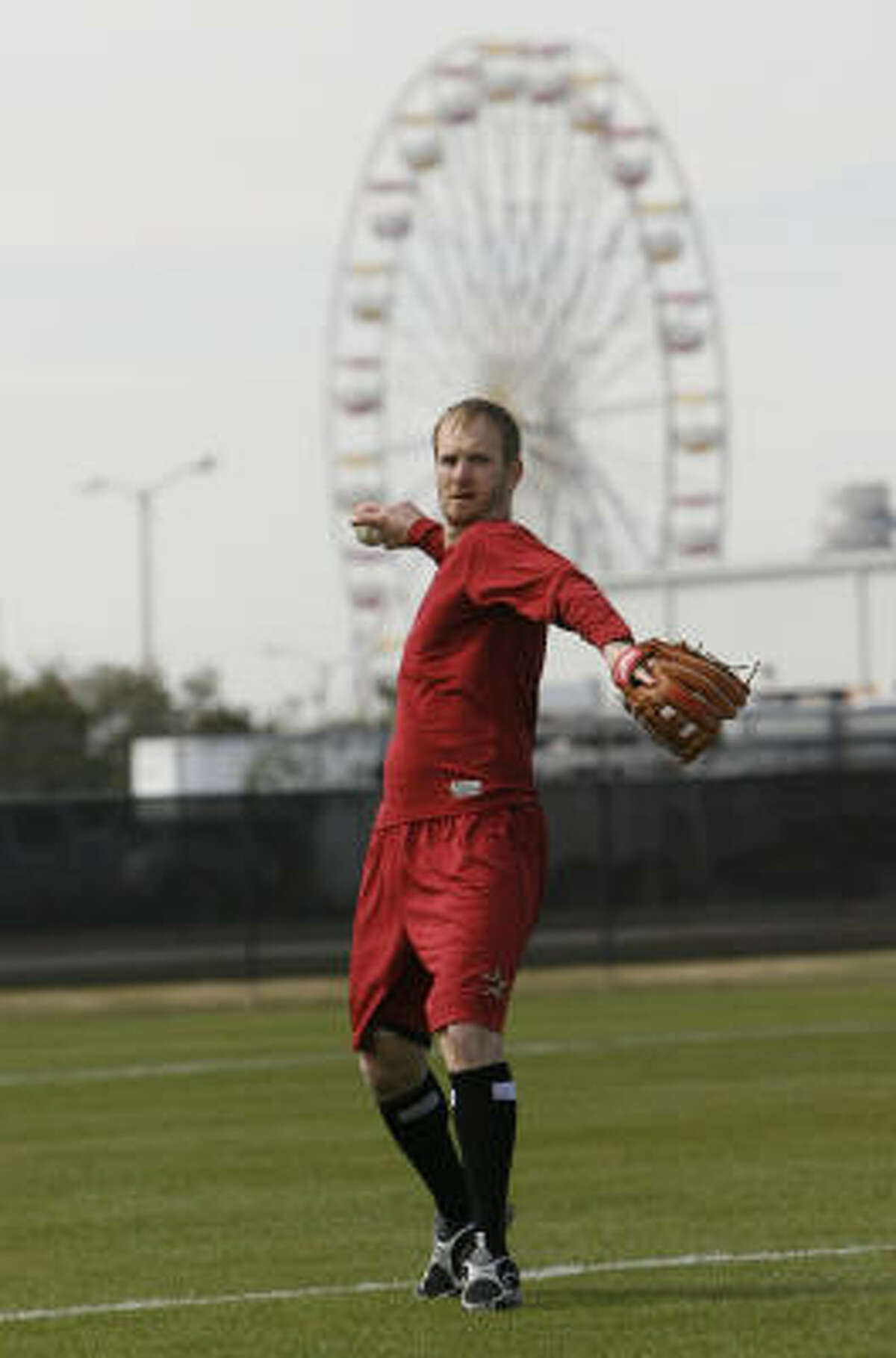 Infielder Jeff Keppinger makes a throw during a light workout at the Astros' spring training facility.