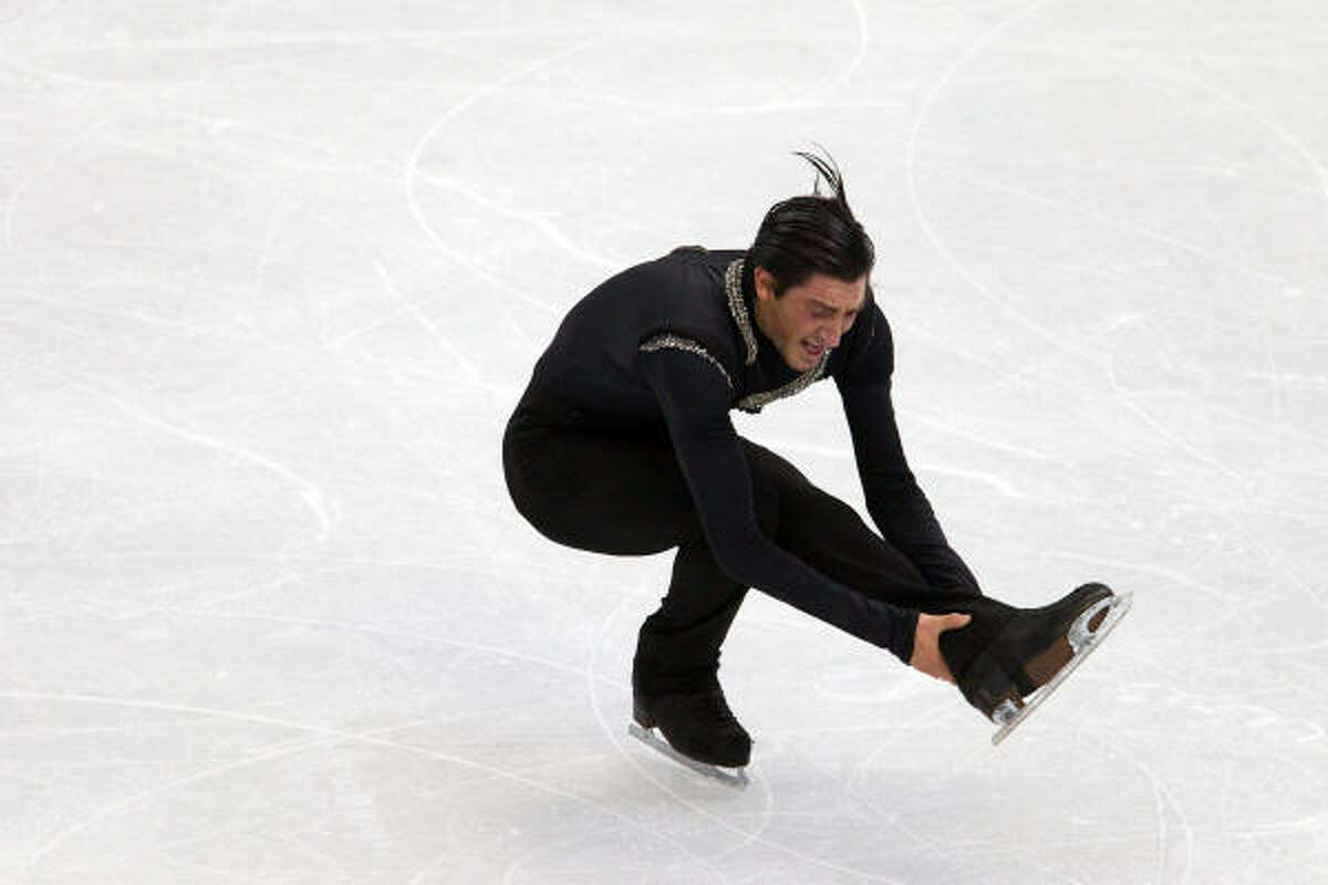 Evan Lysacek totaled 257.67 points to 256.36 for Evgeni Plushenko, the defending gold medalist.