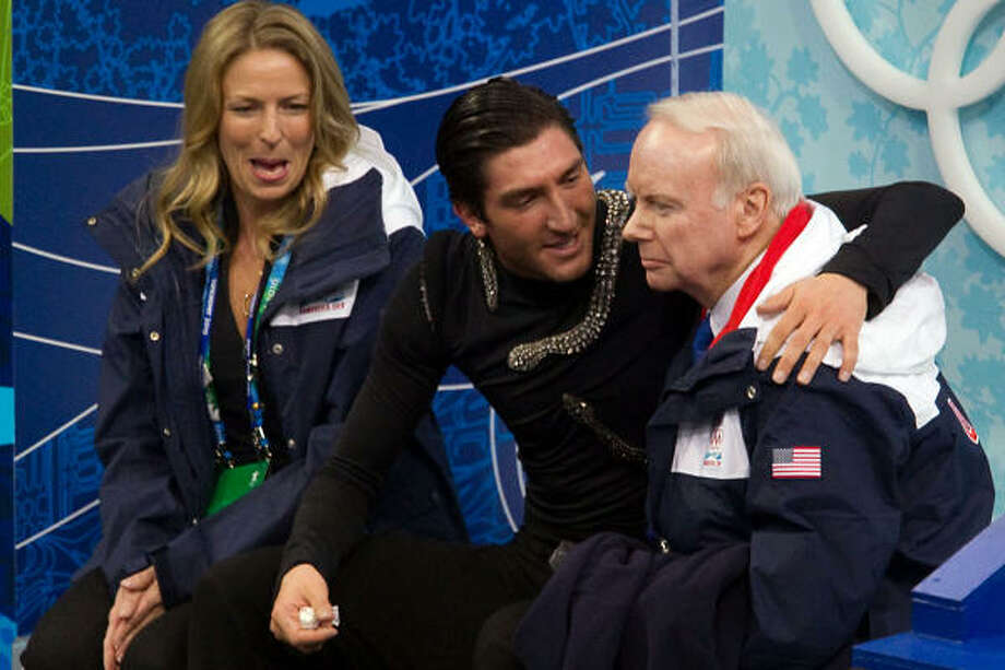Evan Lysacek hugs his coach, Frank Carroll, at the end of his long program. Photo: Smiley N. Pool, Chronicle Olympic Bureau