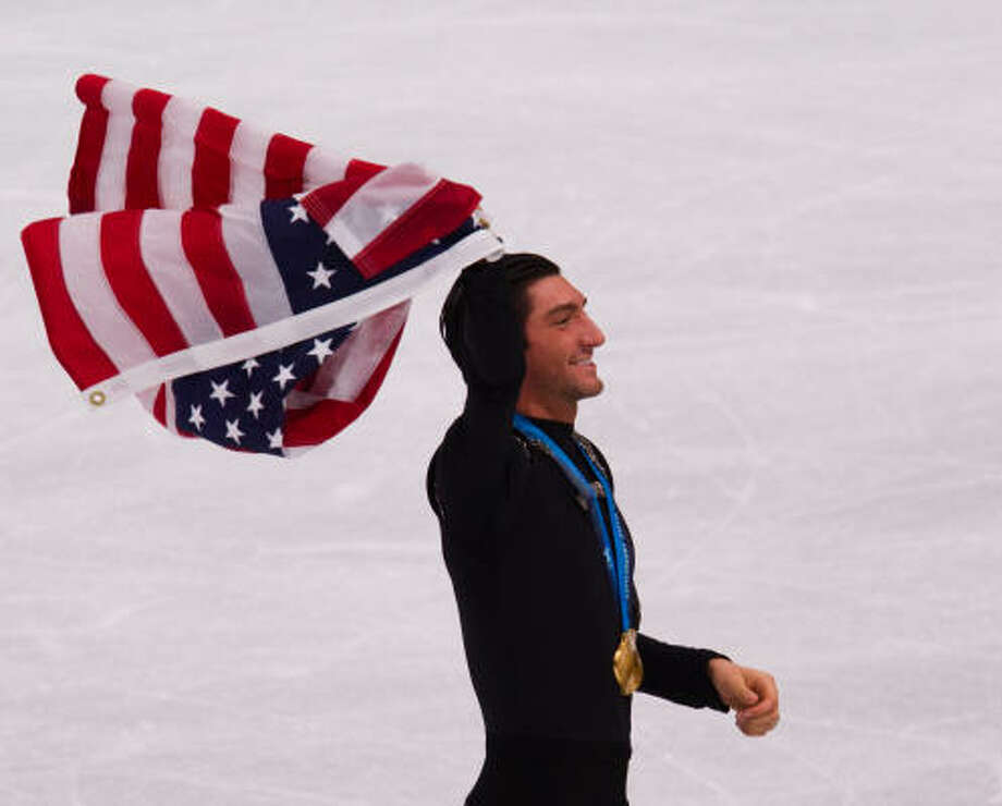 Evan Lysacek nailed a triple lutz-triple toe opening combo and received top marks on four footwork and spin elements. Photo: Smiley N. Pool, Chronicle Olympic Bureau