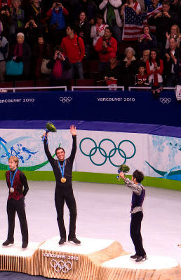 Evan Lysacek waves from the podium after winning the gold. Photo: Smiley N. Pool, Chronicle Olympic Bureau