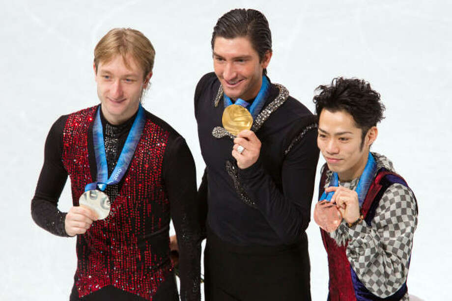 Evgeni Plushenko of Russia, Evan Lysacek of the United States and Daisuke Takahashi of Japan display their medals. Photo: Smiley N. Pool, Chronicle Olympic Bureau