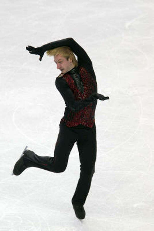 Evgeni Plushenko of Russia was the odds-on favorite because of the quad and the perceived notion he would edge Lysacek in the scores for executed elements — the raw points awarded for jumps, spins and footwork elements. Photo: Smiley N. Pool, Chronicle Olympic Bureau