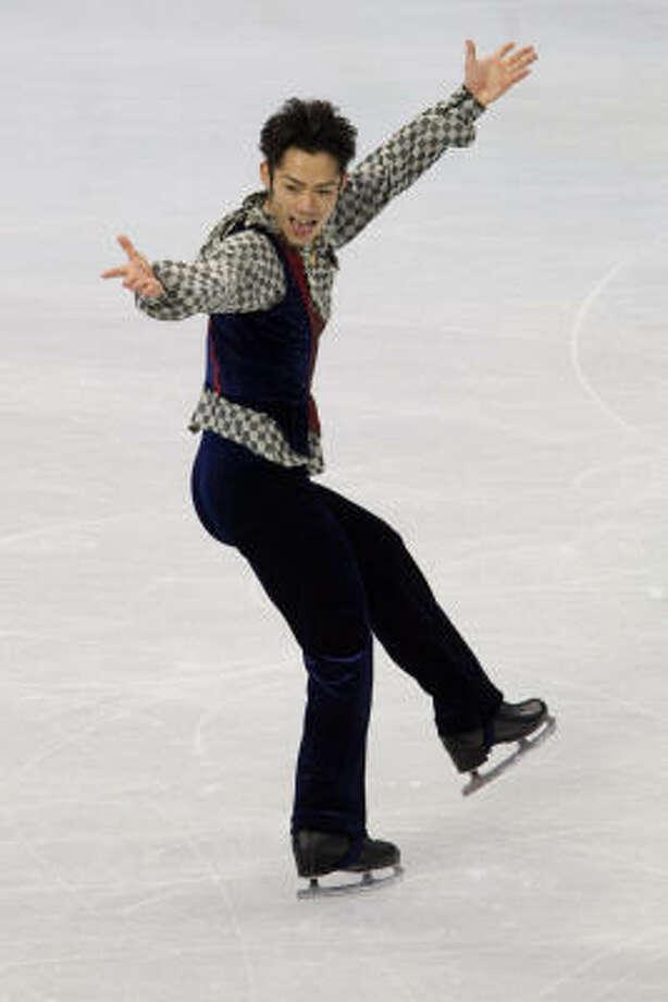 Daisuke Takahashi of Japan won the bronze medal. Photo: Smiley N. Pool, Chronicle Olympic Bureau