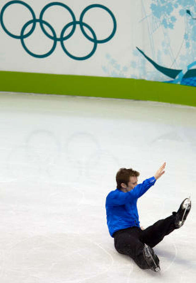 Jeremy Abbott of the U.S. falls as he performs his long program. Photo: Smiley N. Pool, Chronicle Olympic Bureau