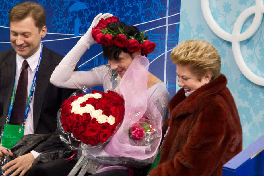 Johnny Weir of the U.S. adjusts a crown of roses after his long program. Photo: Smiley N. Pool, Chronicle Olympic Bureau