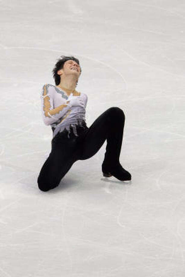 Johnny Weir of the U.S. reacts at the end of his long program. Photo: Smiley N. Pool, Chronicle Olympic Bureau