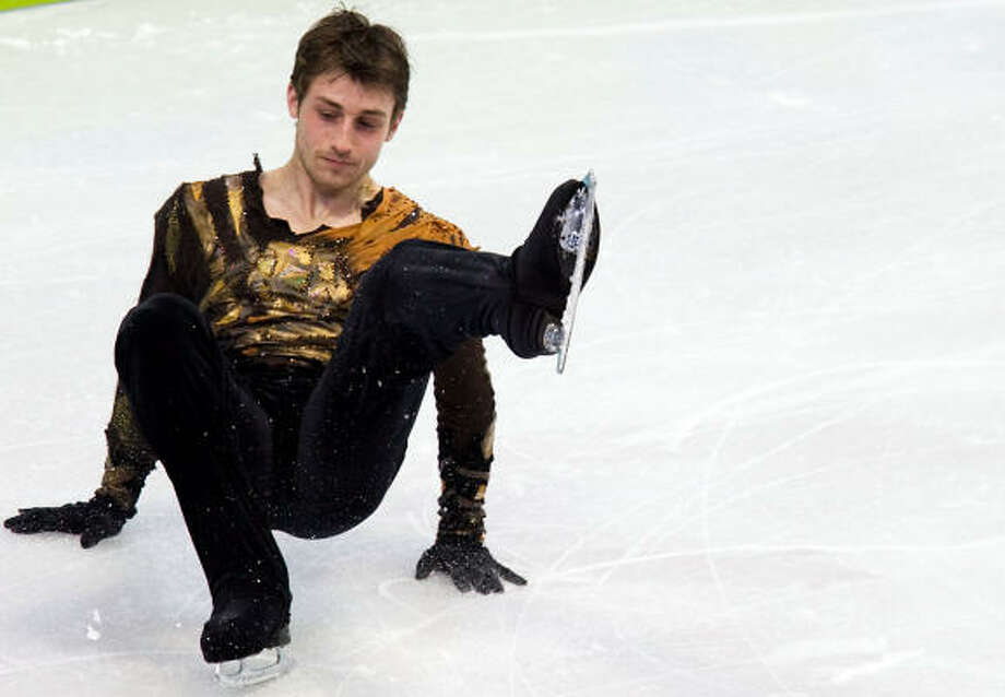 Brian Joubert of France falls as he performs his long program. Photo: Smiley N. Pool, Chronicle Olympic Bureau