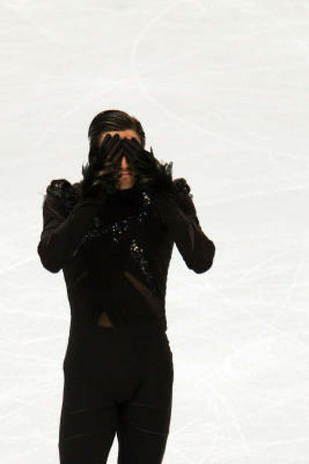 Evan Lysacek was emotionally overwhelmed on the ice after his performance and continued to be upon receiving his score. Photo: Smiley N. Pool, Chronicle Olympic Bureau