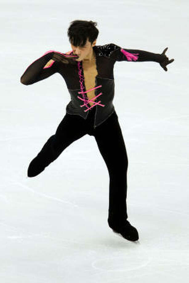 American Johnny Weir performs his short program during men's figure skating action at the 2010 Winter Olympics. Photo: Smiley N. Pool, Chronicle Olympic Bureau