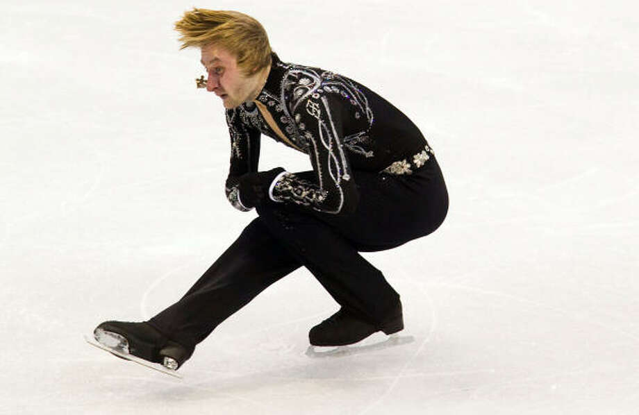 Evgeni Plushenko surged into the lead for the moment with his 90.85 short program. Photo: Smiley N. Pool, Chronicle Olympic Bureau