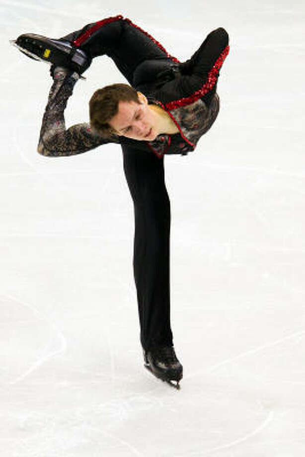 Przemyslaw Domanski of Poland balances on one skate. Photo: Smiley N. Pool, Chronicle Olympic Bureau