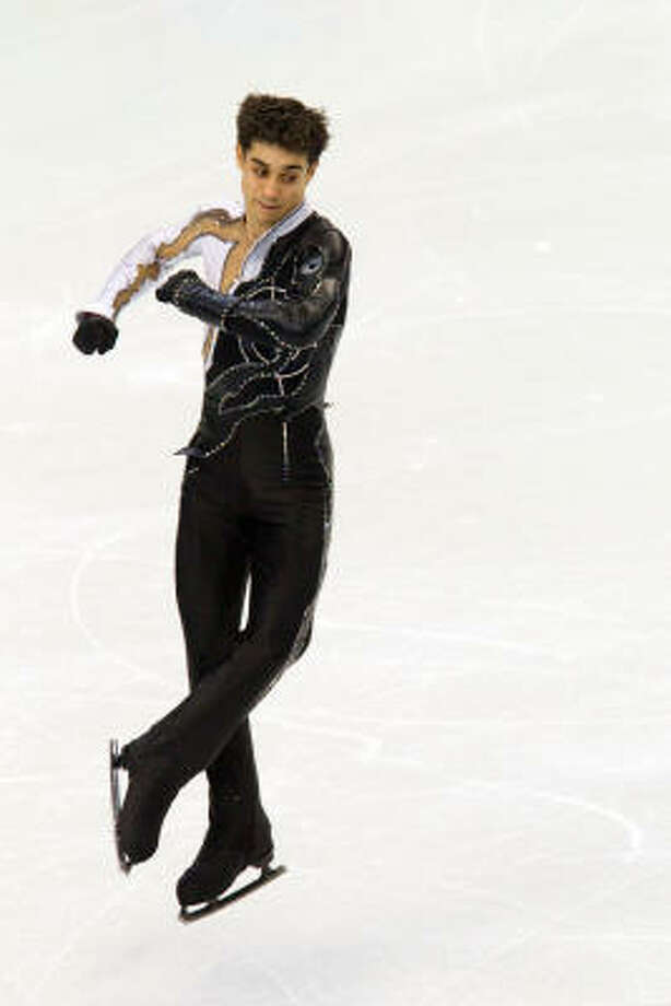 Javier Fernandez of Spain twists through the air. Photo: Smiley N. Pool, Chronicle Olympic Bureau