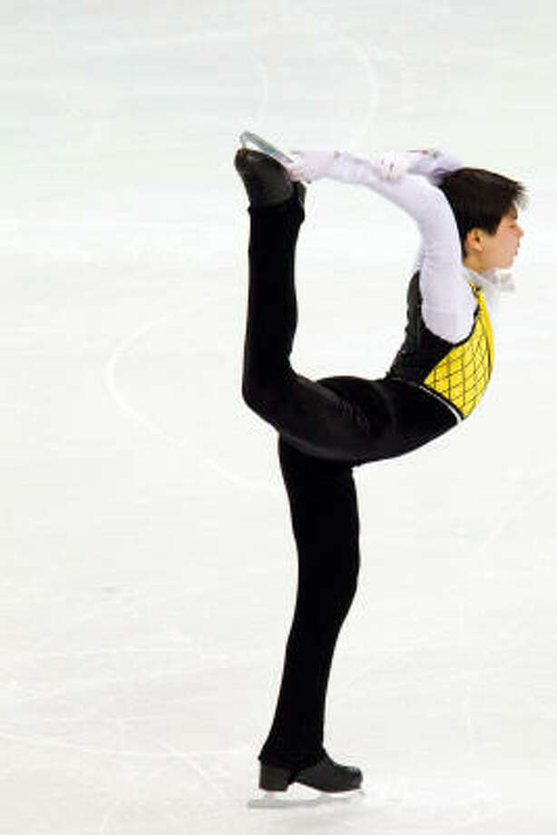 Denis Ten of  Kazakhstan shows off his agility. Photo: Smiley N. Pool, Chronicle Olympic Bureau