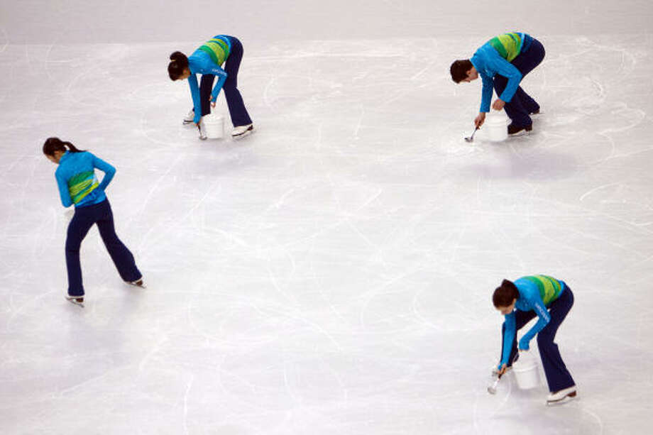 Workers prepare the ice for resurfacing between groups. Photo: Smiley N. Pool, Chronicle Olympic Bureau