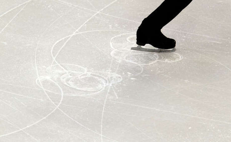 Viktor Pfeifer of Austria cuts a pattern in the ice with his skates during the short program. Photo: Smiley N. Pool, Chronicle Olympic Bureau