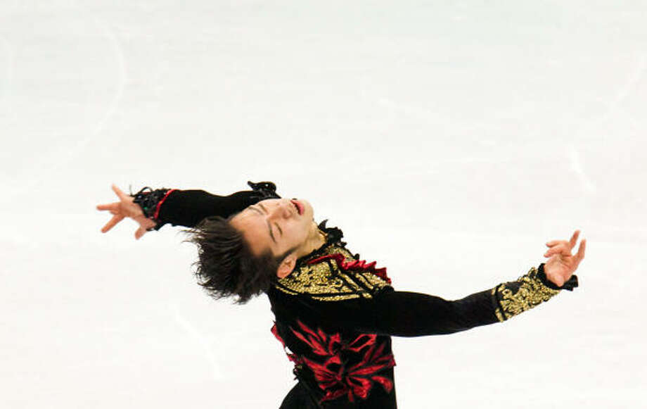 Daisuke Takahashi of Japan performs his short program. Photo: Smiley N. Pool, Chronicle Olympic Bureau