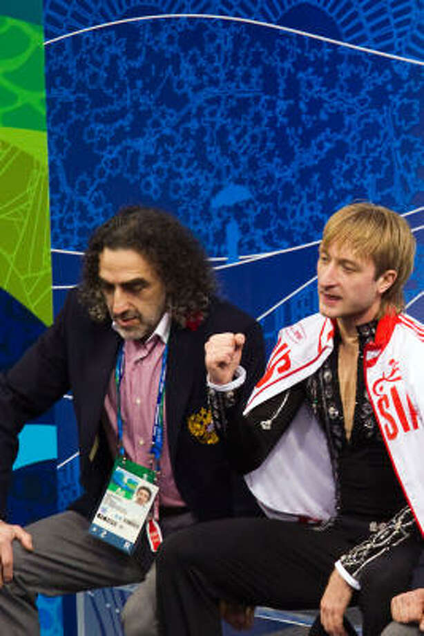 Evgeni Plushenko pumps his fist after receiving the score. Photo: Smiley N. Pool, Chronicle Olympic Bureau