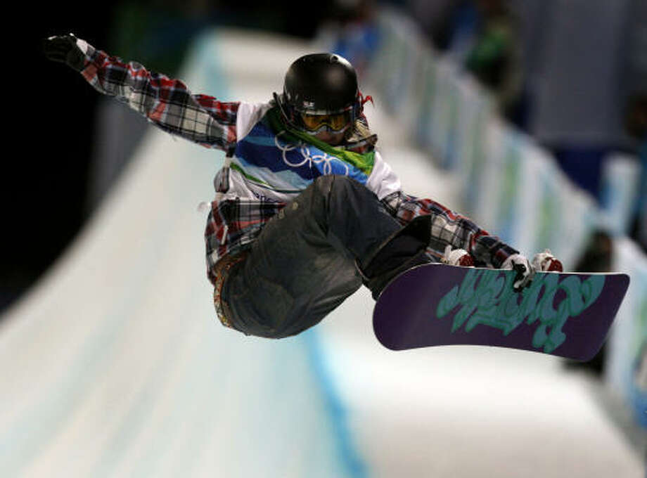 Team USA's Hannah Teter captures the silver medal in the women's snowboard halfpipe competition. Photo: Paul Chinn, Chronicle Olympic Bureau