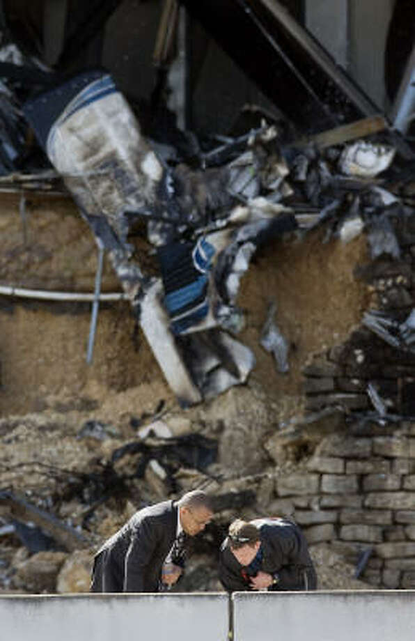 Investigators look for more evidence after the crash on  Thursday. Photo: Ralph Barrera, Austin American-Statesman