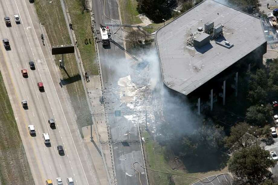 The Piper Cherokee took off from Georgetown this morning and struck the building at 9430 Research Boulevard in northwest Austin before 10 a.m Photo: Alberto Martinez, AP