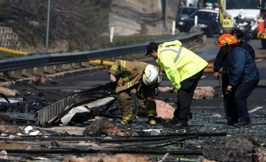 Officials investigate the scene of the crash. Photo: RODOLFO GONZALEZ, AP