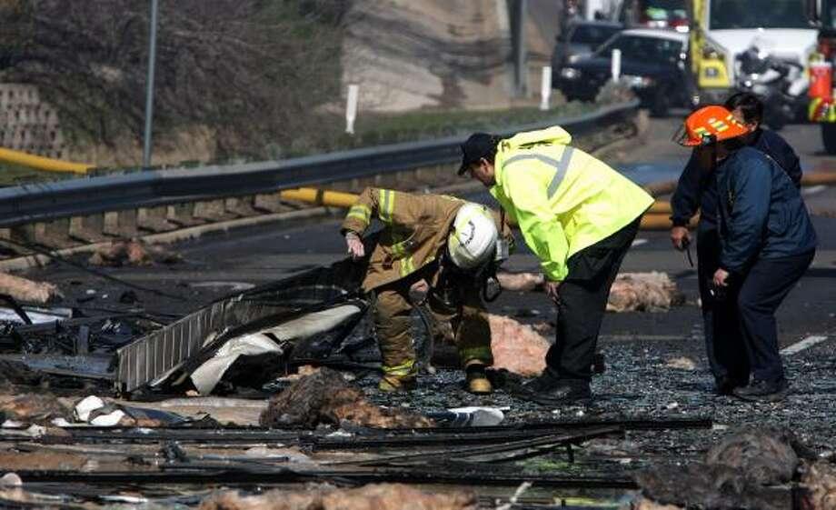 Officials investigate the scene of the crash. Photo: RODOLFO GONZALEZ, AP